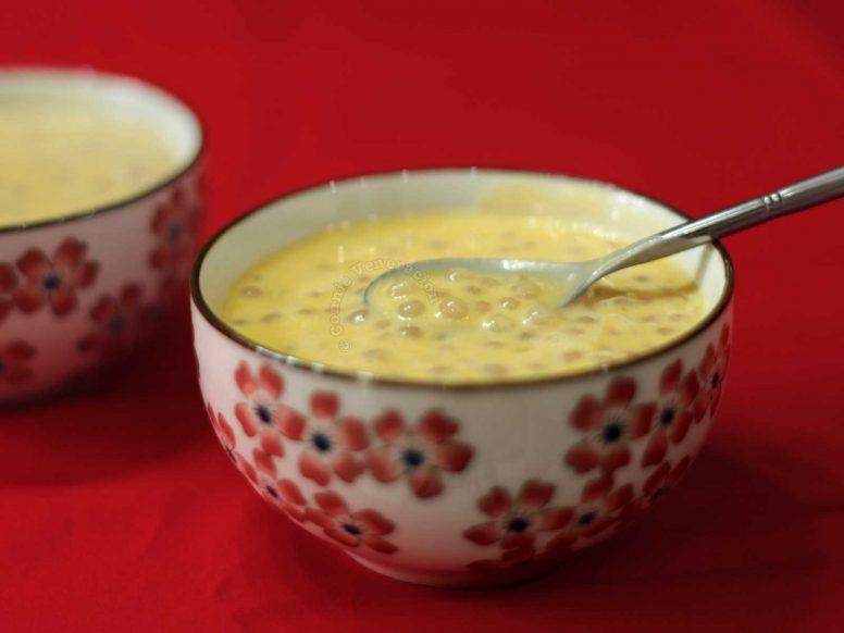 Mango sago in bowl set over red background