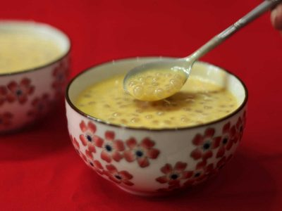 Mango sago in white bowl with red flowers