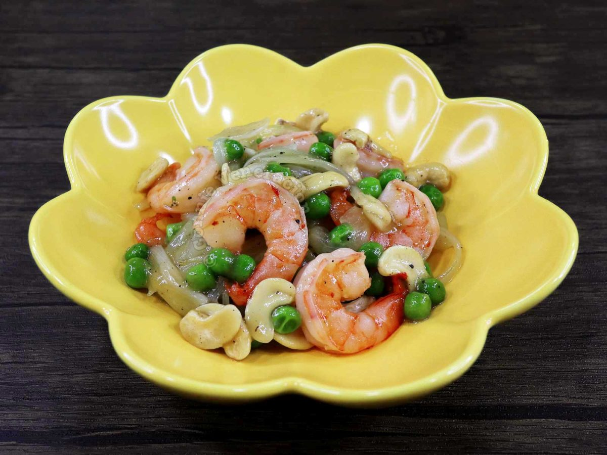 Shrimp Peas and Cashew Stir Fry in a Yellow Bowl