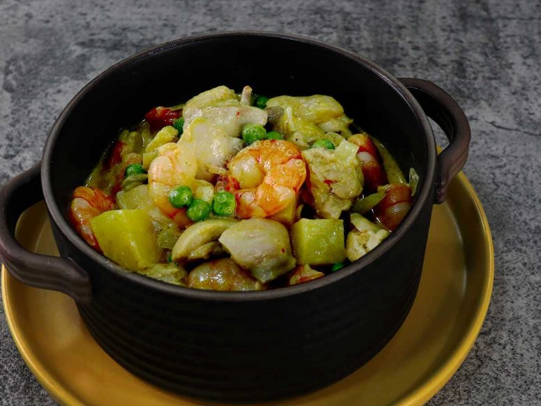 Chicken and shrimp curry with potatoes and peas