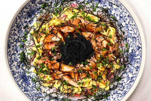 Chirashizushi (Scattered Sushi) with Salmon, eggs, tobiko, nori and sakura denbu