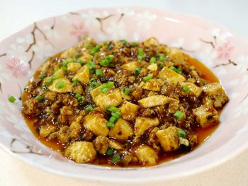 Ma po tofu garnished with scallions