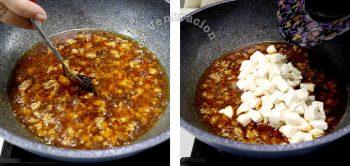 Adding tofu to ground pork in wok to make ma po tofu