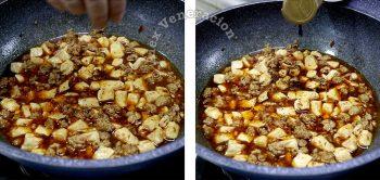 Sprinkling grouns Sichuan peppercorns on ma po tofu in wok