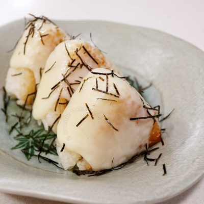 Tuna onigiri covered with melted mozzarella and sprinkled with kizami nori