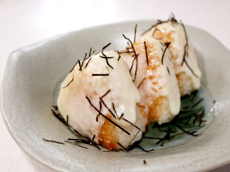 Cheesy tuna onigiri in a shallow green stoneare bowl