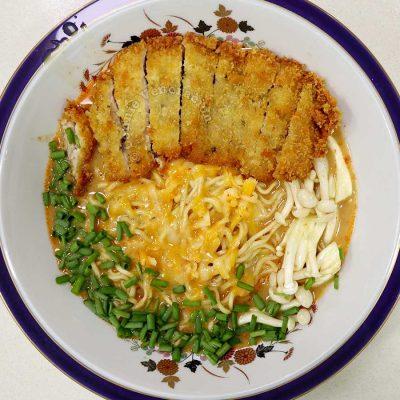 Instant chicken curry ramen with chicken katsu, shimeiji, cheese and scallions