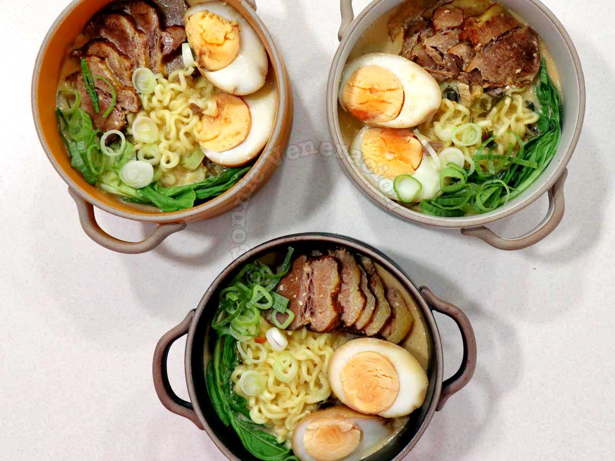 Three Bowls of Kewpie Mayo and Sesame Ramen With Beef Slices, Bok Choy and Hard-boiled Eggs