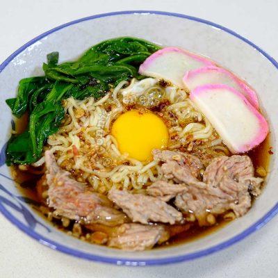 Sweet Shoyu Beef Ramen With Egg and Kamaboko