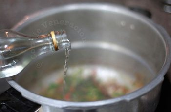 Pouring rice wine into pan