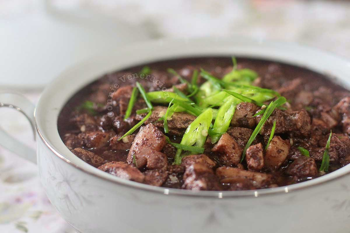 Dinuguan (Pork Blood Stew) Garnished with Sliced Green Chilies and Scallions