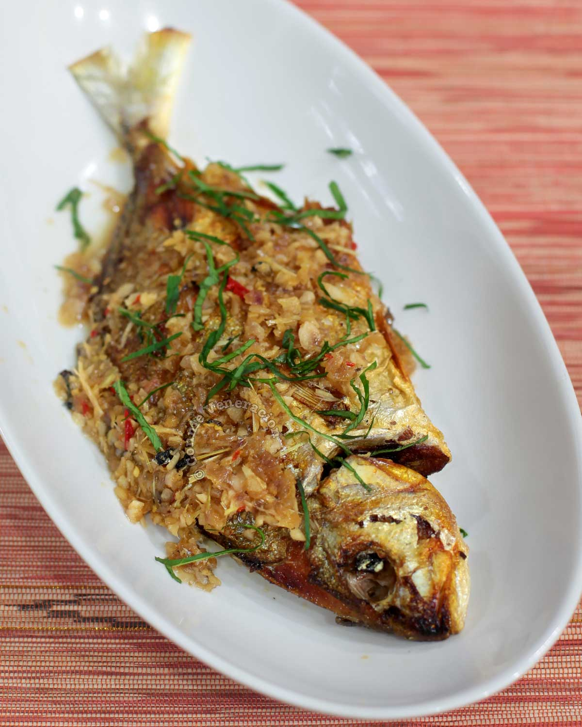 Whole Fish with Lemongrass and Ginger Sauce in White Bowl