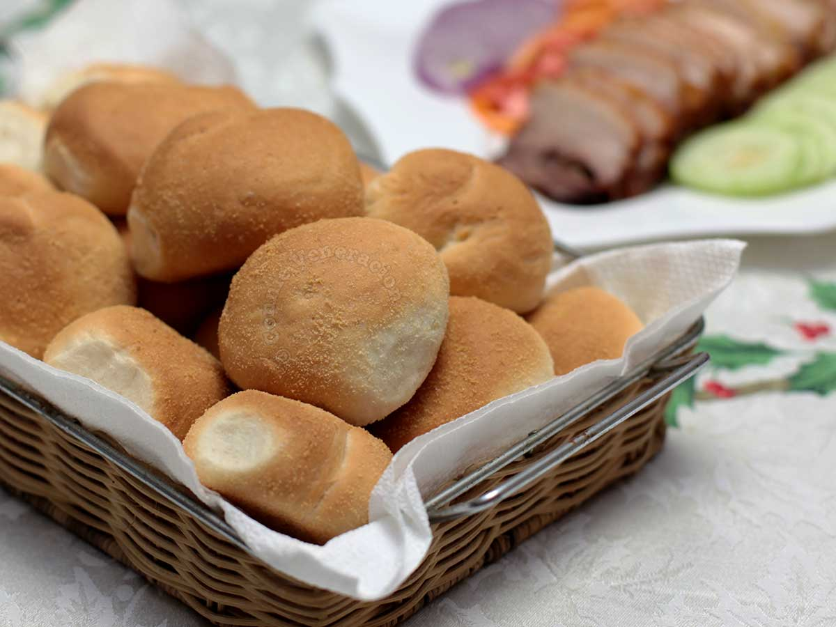 A basket of pan de sal on the dining table
