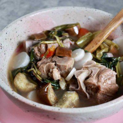Pork ribs sinigang with eggplants, radish and kangkong