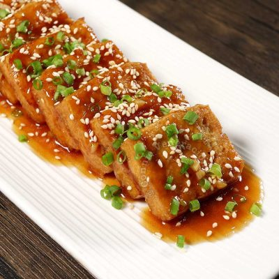 Tofu in Oyster Sauce Garnished with Sesame Seeds and Scallions